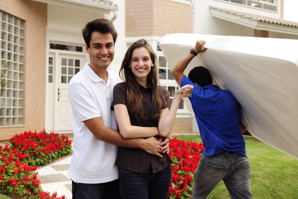 Young couple buying a mattress